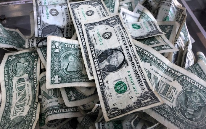 The American dollar was down on Monday afternoon in London's trading session giving up little of its gains from Friday's trading session.
